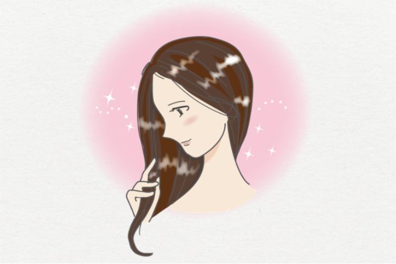 背景ありの写真、髪に艶のある女性。